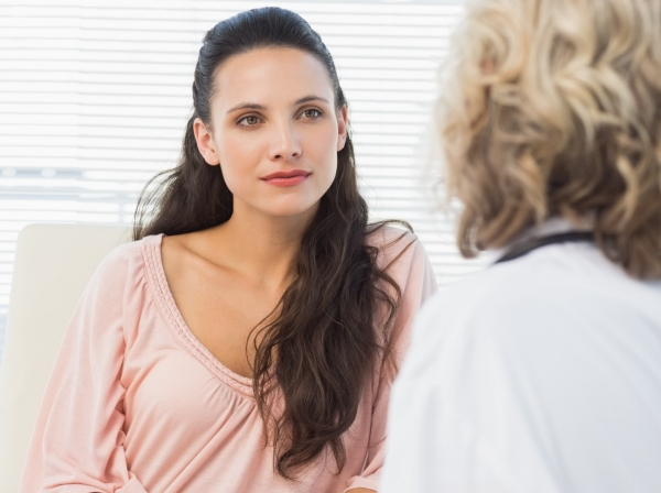 A woman listening to her doctor