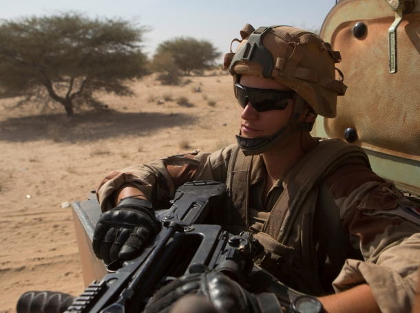 A French soldier from Operation Barkhane rides in an armoured vehicle in Timbuktu, November 5, 2014