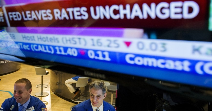 Traders work on the floor of the New York Stock Exchange after an announcement by the Federal Reserve, October 28, 2015