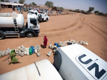 The distribution of 40,000 litres of water is seen among in El Srief, North Darfur, July 25, 2011