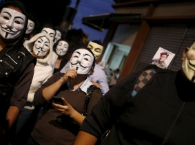 Protesters from the online activist group Anonymous, photo by Jorge Dan Lopez/Reuters