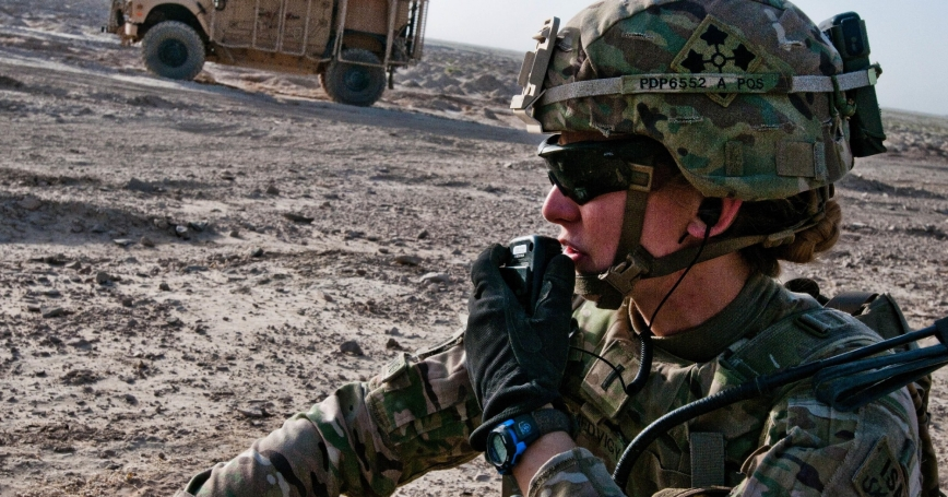 U.S. Army soldier conducts a call-for-fire during an artillery shoot south of Kandahar Airfield, Afghanistan, August 22, 2014