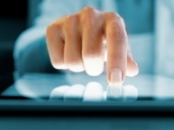 Closeup of a hand using a digital tablet