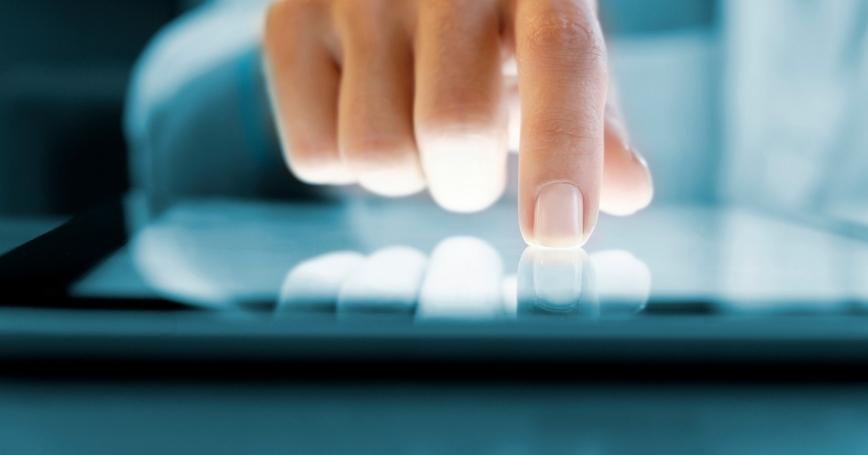 Closeup of a hand using a digital tablet