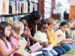 Children reading in a library