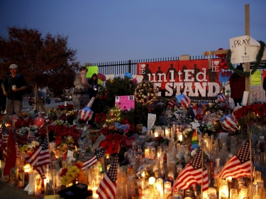 Flowers and candles are displayed at a makeshift memorial after the December 2, 2015 shooting in San Bernardino, California