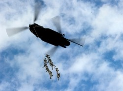 Soldiers from 7th Special Forces Group Airborne are suspended by a CH-47 Chinook helicopter during a training event Eglin Air Force Base, February 5, 2013