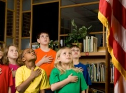 Students pledging allegiance to the American flag