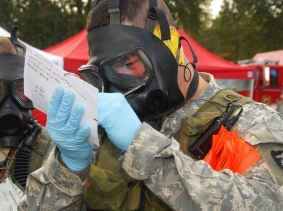 Two Oregon Army National Guard members make notes from the edge of the blast zone after a simulated dirty bomb detonated during an exercise in Portland, October 16, 2007, photo by Senior Airman John Hughel / U.S. Air Force CC BY 2.0