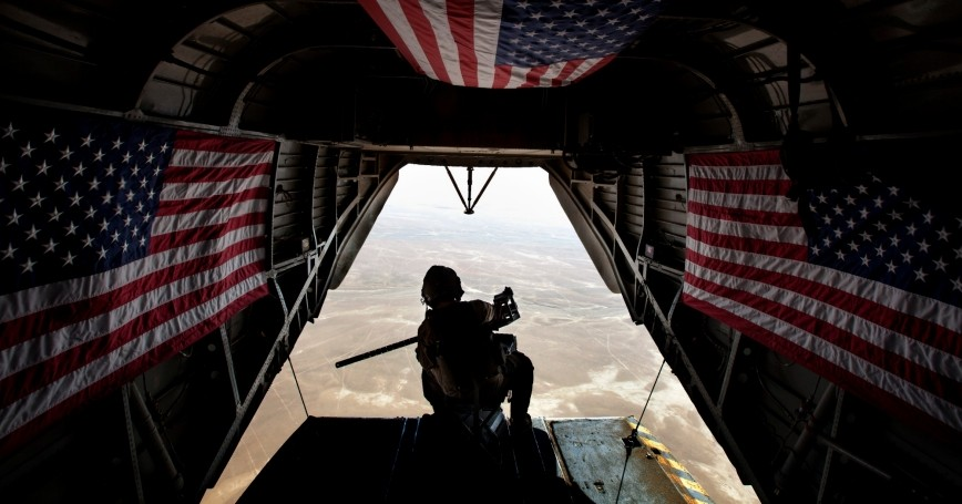 Marines scan the area for insurgent activity during a general support flight over Helmand province, Afghanistan