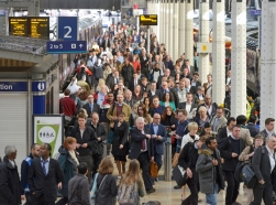 Morning commuters arrive and depart from Paddington Railway Station in London