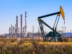 Pumpjack and oil refinery plant in West Texas