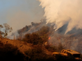 A Super Scooper aircraft battles a 40-acre fire east of the Sepulveda Pass in Los Angeles, photo by Gus Ruelas/Reuters