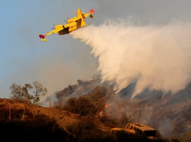 A Super Scooper aircraft battles a 40-acre fire east of the Sepulveda Pass in Los Angeles