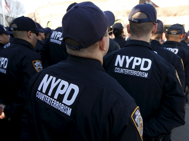 Members of the New York City Police Department's Critical Response Command anti-terrorism unit stand in formation on Randall's Island in New York City, November 16, 2015