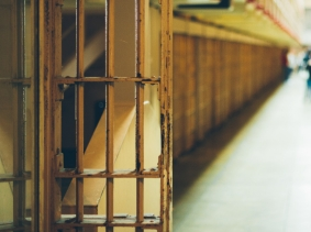 An open prison cell door, photo by offfstock/Fotolia