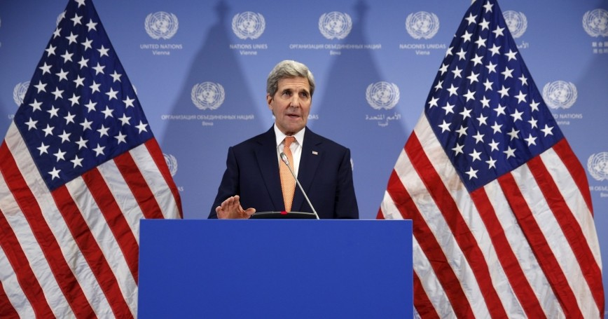 U.S. Secretary of State John Kerry delivers a statement that sanctions will be lifted on Iran after the IAEA verified that Iran has met all conditions under the nuclear deal, January 16, 2016