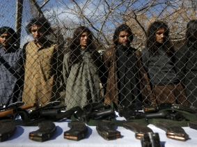 Pakistani Taliban fighters, who were arrested by Afghan border police, stand during a presentation of seized weapons and equipment in Kabul, Afghanistan, January 5, 2016, photo by Omar Sobhani/Reuters