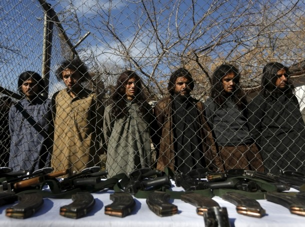 Pakistani Taliban fighters, who were arrested by Afghan border police, stand during a presentation of seized weapons and equipment in Kabul, Afghanistan, January 5, 2016