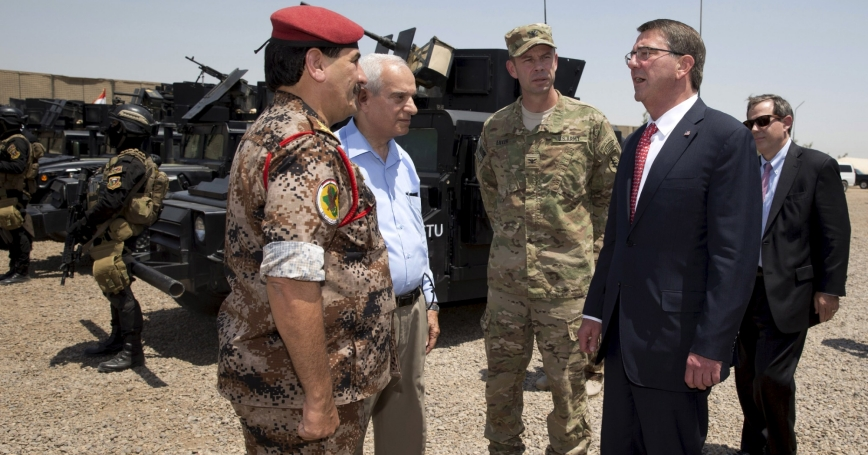 U.S. Defense Secretary Ash Carter stands with Col. Otto Liller as he is greeted by Iraqi Major General Falah al Mohamedawi (L) at the Iraqi Counter Terrorism Service Academy in Baghdad, July 23, 2015