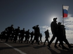 Russian servicemen walk in formation as they take part in a rehearsal for the Victory Day military parade in the Crimean port of Sevastopol, April 16, 2015