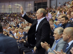 Russian President Vladimir Putin greets spectators at the World Judo Championships in Chelyabinsk