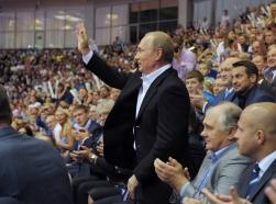 Russian President Vladimir Putin greets spectators at the World Judo Championships in Chelyabinsk