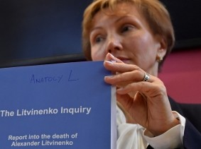 Marina Litvinenko, widow of murdered ex-KGB agent Alexander Litvinenko, poses with a copy of The Litvinenko Inquiry Report with her son Anatoly during a news conference in London, Britain, January 21, 2016