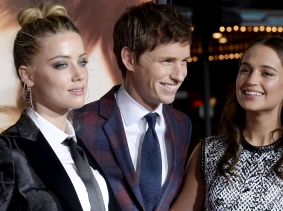 "Cast members Amber Heard (left), Eddie Redmayne (center), and Alicia Vikander pose during the premiere of ""The Danish Girl"" in Los Angeles, California, November 21, 2015"