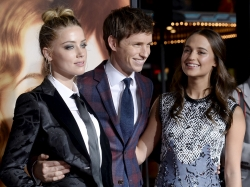 """Cast members Amber Heard (left), Eddie Redmayne (center), and Alicia Vikander pose during the premiere of """"The Danish Girl"""" in Los Angeles, California, November 21, 2015"""