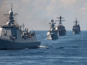The Chinese Luyang II-class guided missile destroyer Jinan and other ships in formation during a passing exercise, November 7, 2015