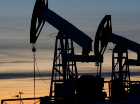 Pump jacks are seen at the Lukoil company owned Imilorskoye oil field, as the sun sets, outside the West Siberian city of Kogalym, Russia, January 25, 2016