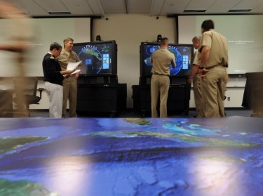 Naval officers from the Colombian, Brazilian, and U.S. Navy work together as a control group at U.S. Naval War College during the 2013 Inter-American War Game