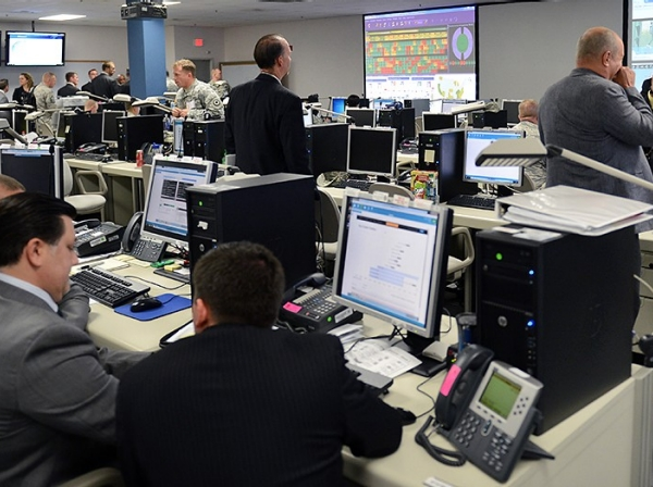 Service members and civilians conduct simulated cyberattack scenarios during Cyber Guard 2015