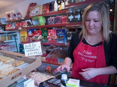 A woman works at a Polish delicatessen in Grays, Britain, December 11, 2015