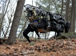 The Defense Advanced Research Projects Agency's Legged Squad Support System can relieve troops of their 100-pound equipment load, take voice commands, and maneuver around obstacles, in addition to numerous other tasks in the field