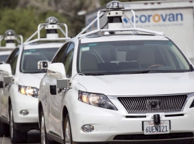 A line of Lexus SUVs equipped with Google self-driving sensors awaits test riders in Mountain View, California, September 29, 2015