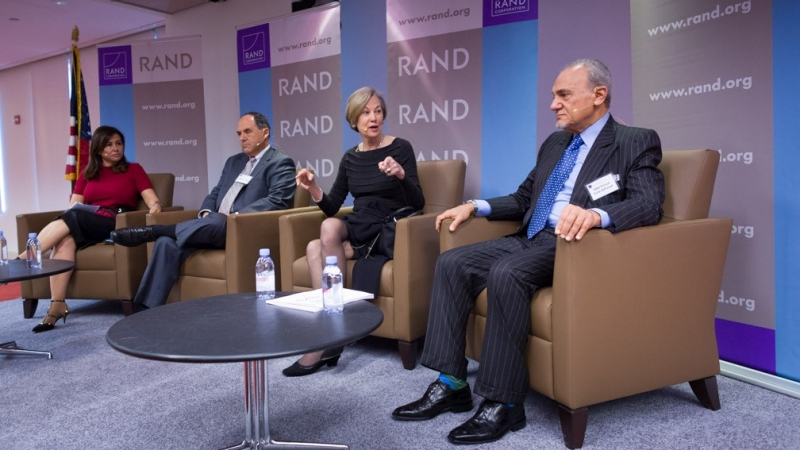 Karen Elliott House, chairman of RAND Board of Trustees, discusses Iran in a regional context as L-R moderator Nadia Bilbassy-Charters of Al Arabiya, Chuck Freilich of Harvard Kennedy School, and HRH Prince Turki AlFaisal look on