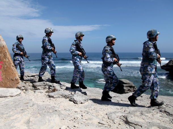 Soldiers of China's People's Liberation Army Navy patrol at Woody Island, in the Paracel Archipelago, which is known in China as the Xisha Islands, January 29, 2016