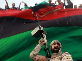 One of the members of the military protecting a demonstration against candidates for a national unity government proposed by U.N. envoy for Libya Bernardino Leon, in Benghazi, Libya, October 23, 2015