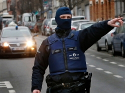 Police at the scene of a security operation in the Brussels suburb of Molenbeek in Belgium, March 18, 2016
