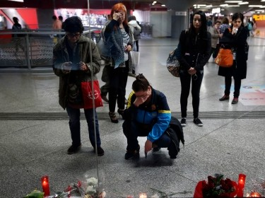 Women gather by a memorial for the victims of the March 11, 2004 train bombings at Atocha station, in Madrid