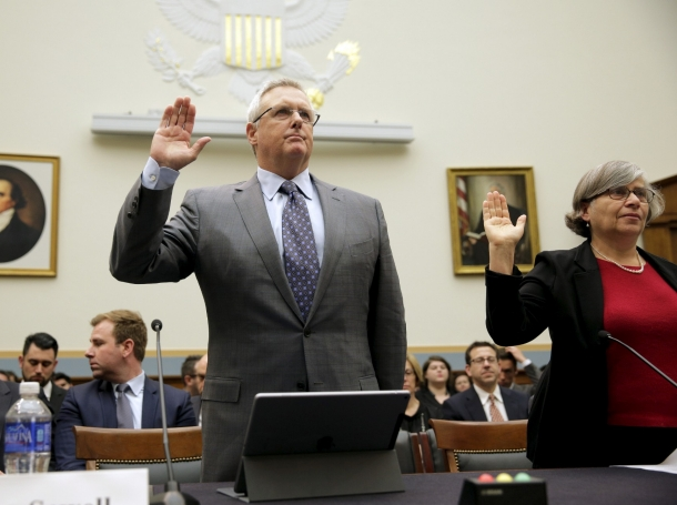 """Bruce Sewell, senior vice president and general counsel for Apple Inc., is sworn in before testifying to the House Judiciary hearing on """"The Encryption Tightrope: Balancing Americans' Security and Privacy"""" March 1, 2016"""