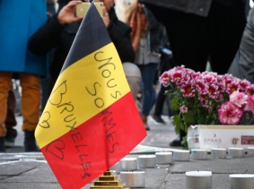 People gather around a memorial in Brussels, Belgium following terrorist bombings, March 22, 2016, photo by Charles Platiau/Reuters