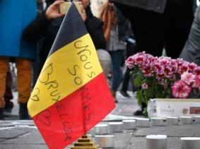 People gather around a memorial in Brussels, Belgium following terrorist bombings, March 22, 2016