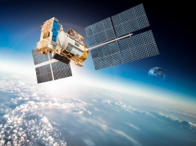 A satellite orbiting Earth, photo by Andrey Armyagov/Fotolia