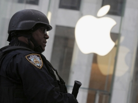 An NYPD officer stands across the street from the Apple Store on 5th Ave. in New York, March 11, 2016