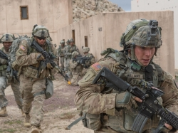 Soldiers participate in a clearance operation exercise in a mock town at the National Training Center, February 18, 2016