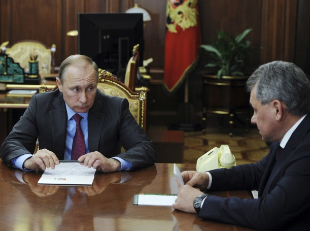 Russian President Vladimir Putin meets with Defense Minister Sergei Shoigu at the Kremlin in Moscow, March 14, 2016