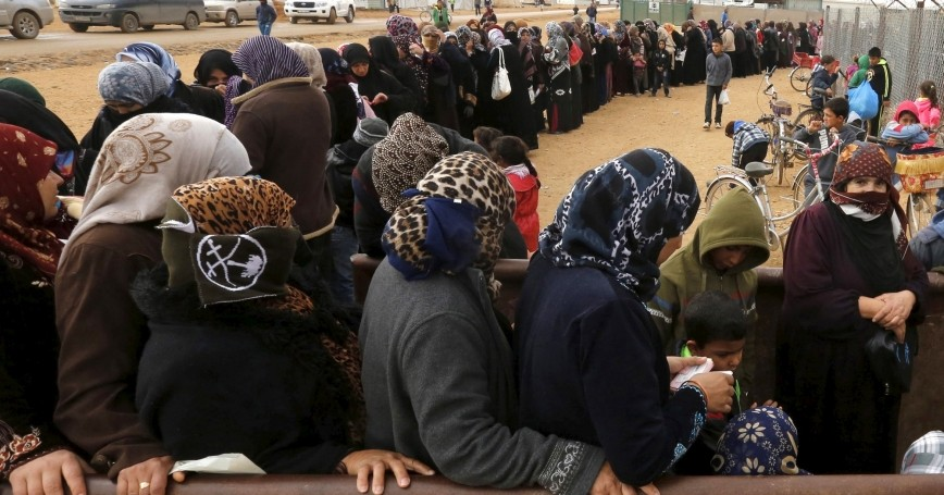 Syrian refugees stand in line as they wait for aid packages at Al Zaatari refugee camp in Mafraq, Jordan, January 20, 2016